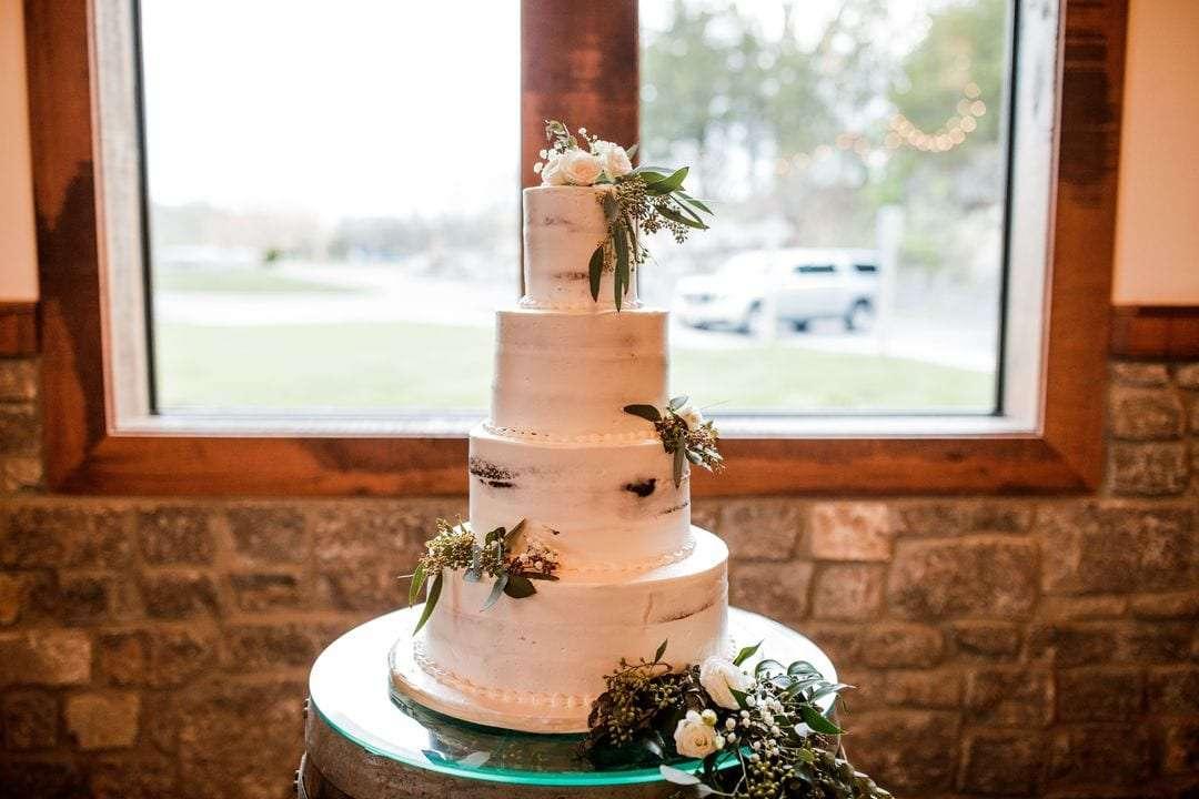 white naked wedding cake with flowers