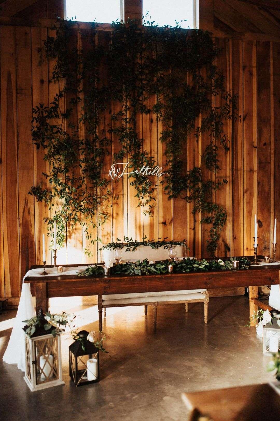wedding sweetheart table floral backdrop