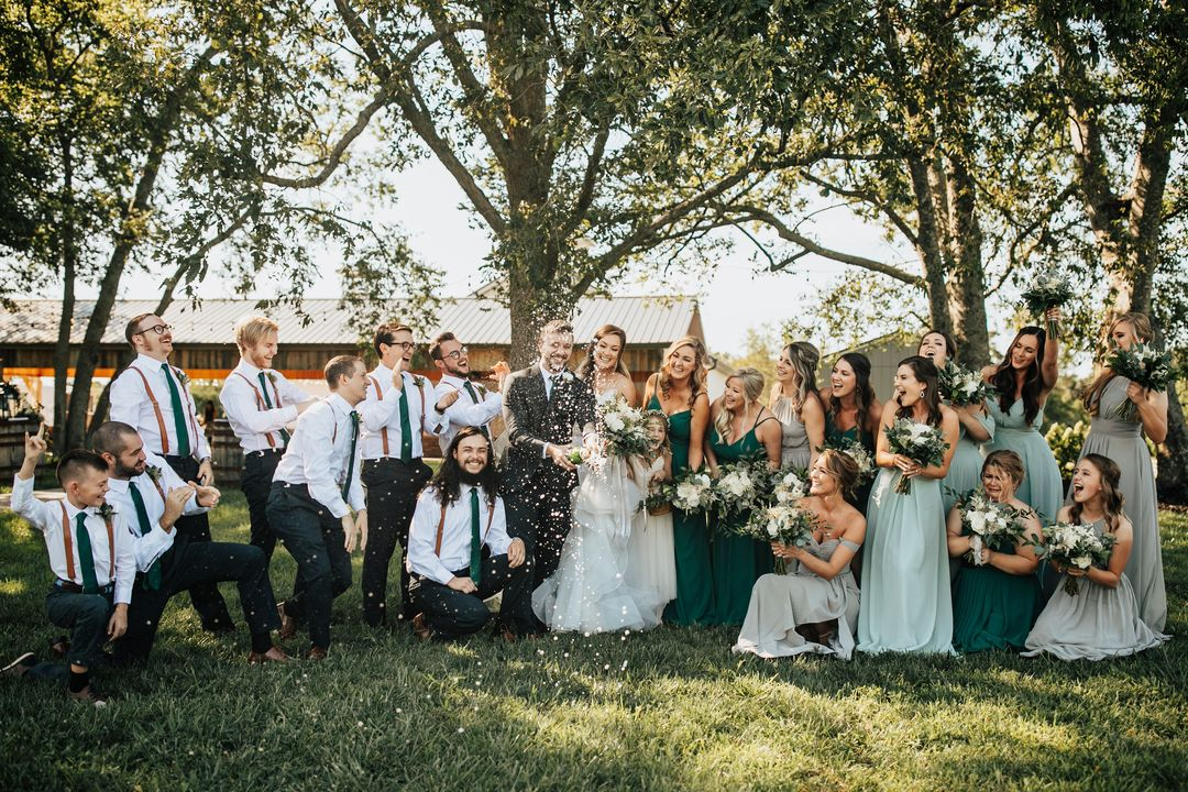 green and black wedding party portraits