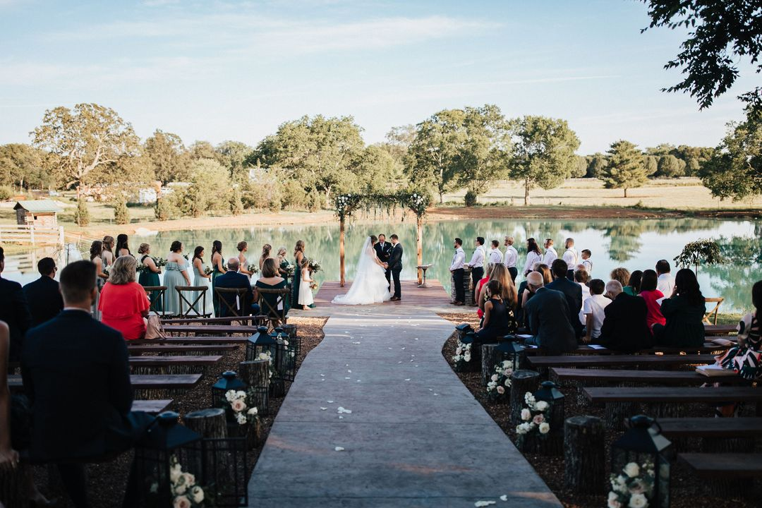 wedding ceremony outdoors by lake