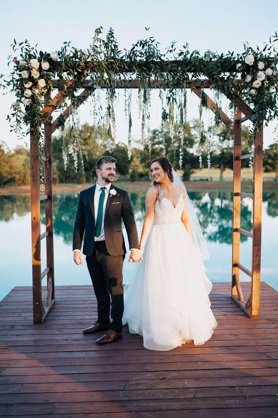 outdoor wedding ceremony arbor with flowers