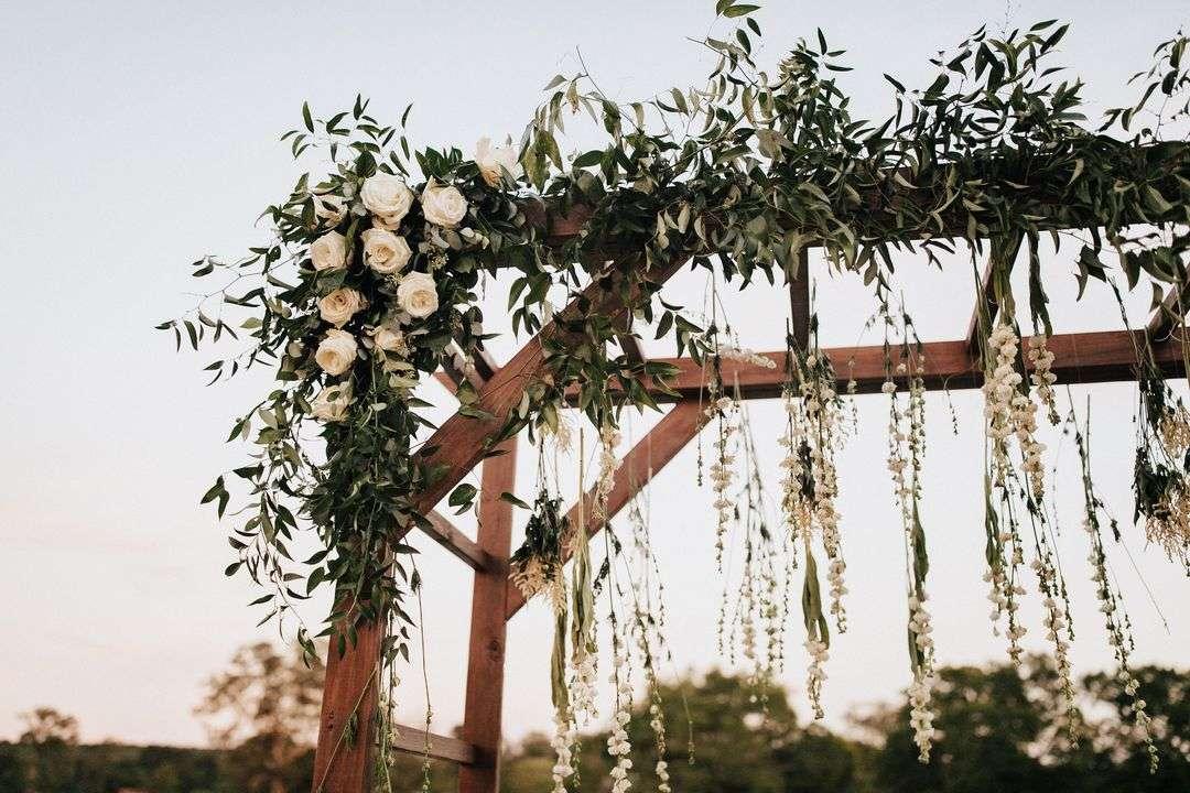 wedding ceremony floral arrangement white roses