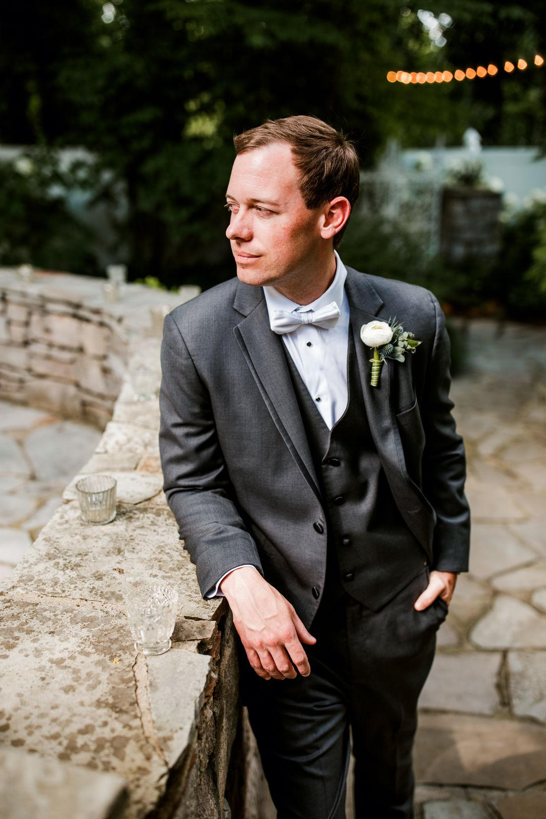 groom portraits and white boutonierre