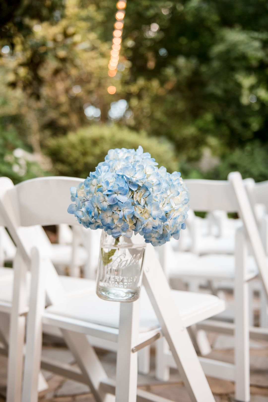 blue florals ceremony aisle decor
