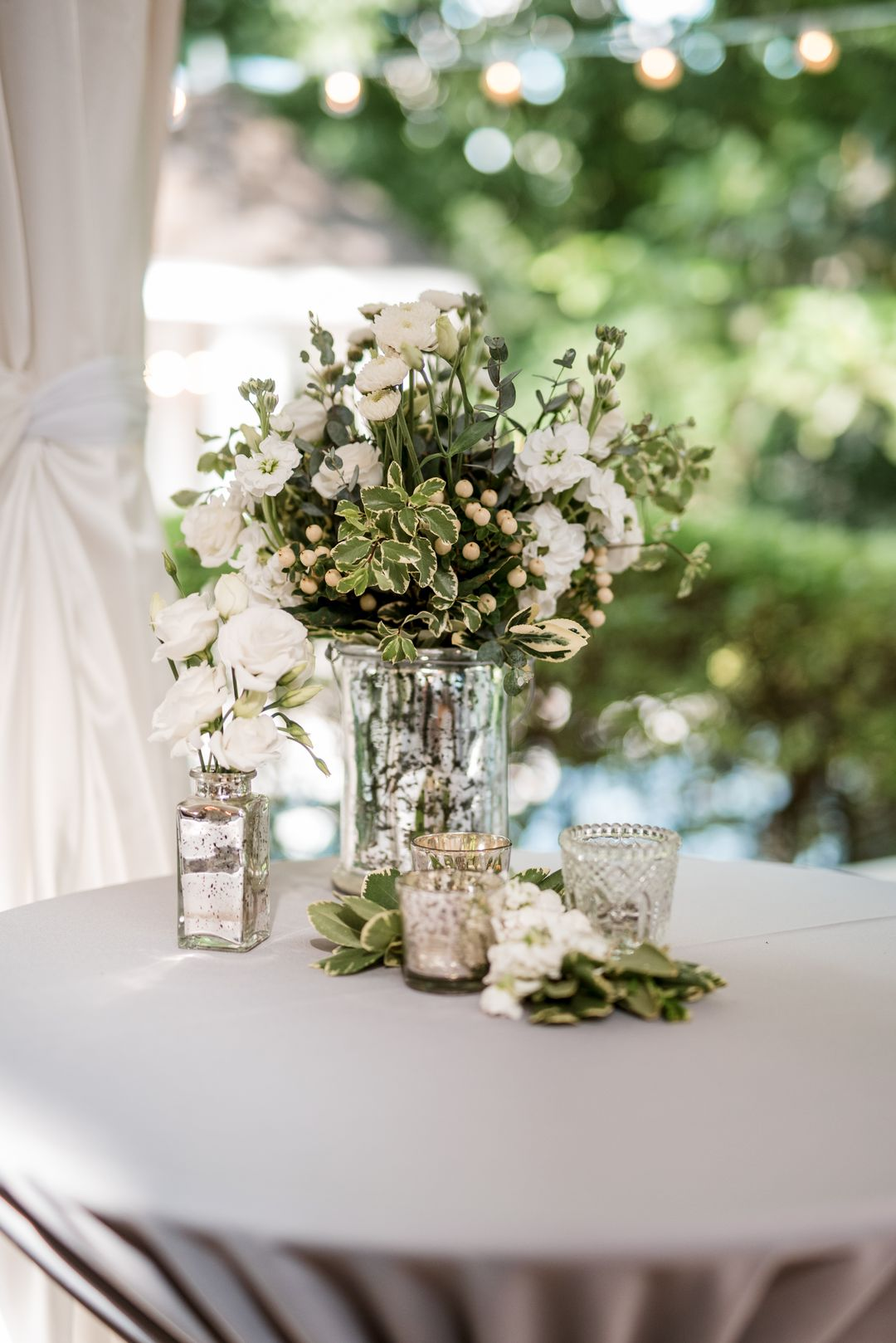 white and sage wedding centerpieces