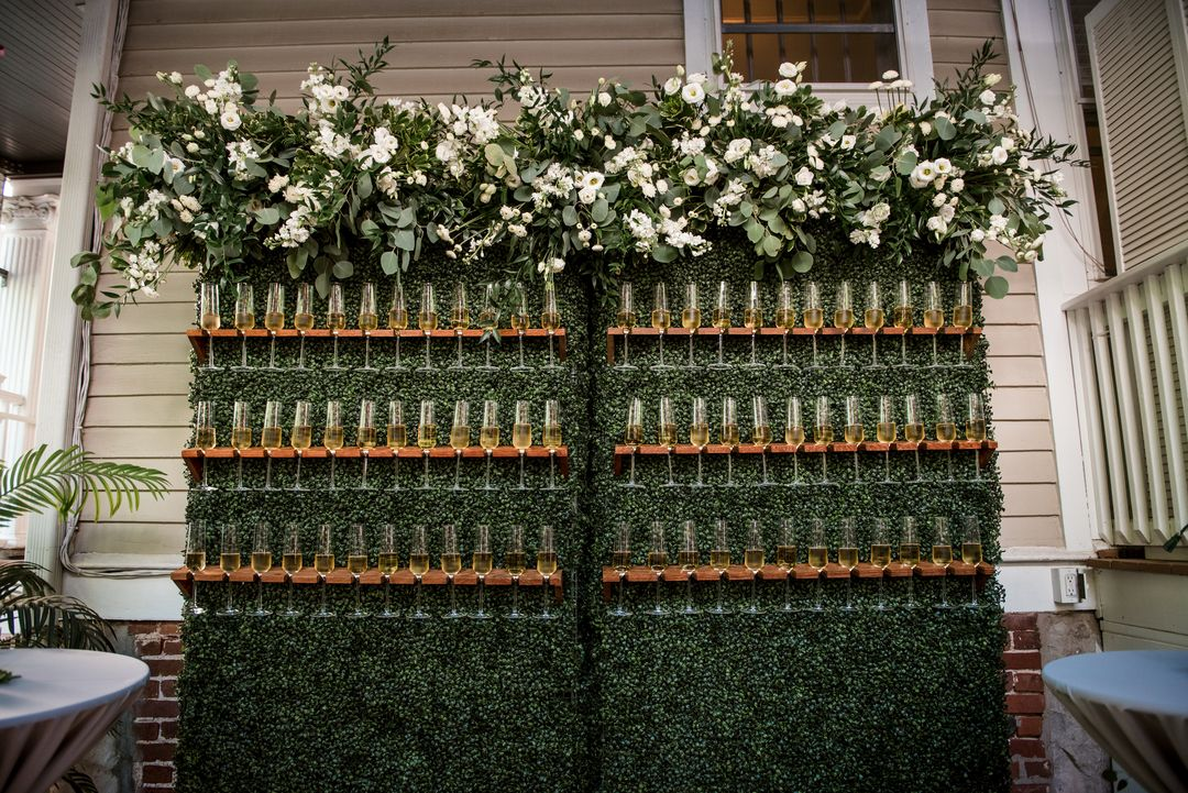 champagne wall wedding florals