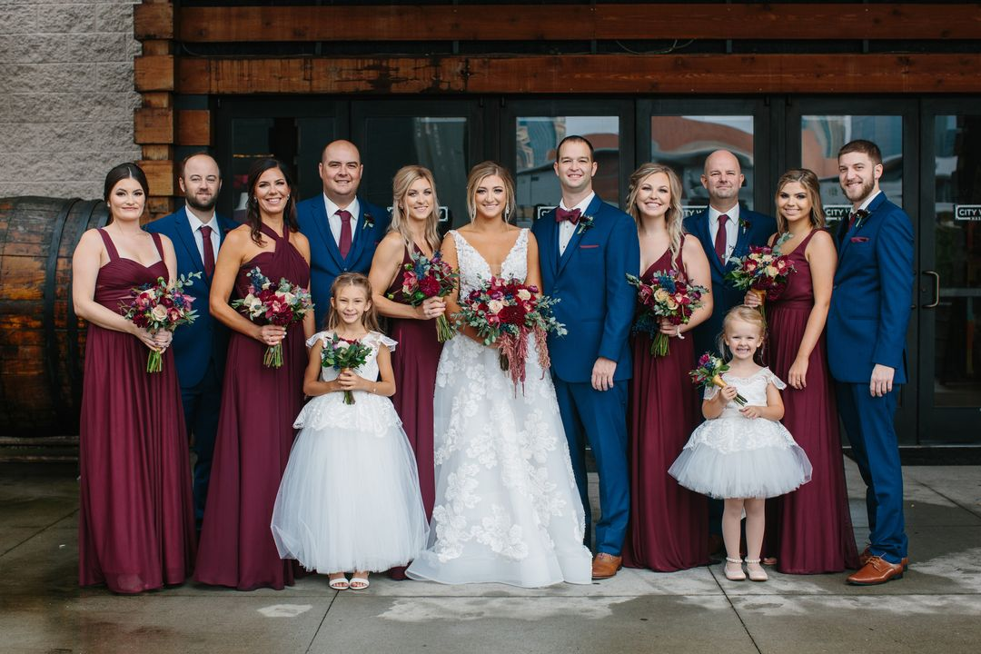 bold burgundy and blue wedding party portraits