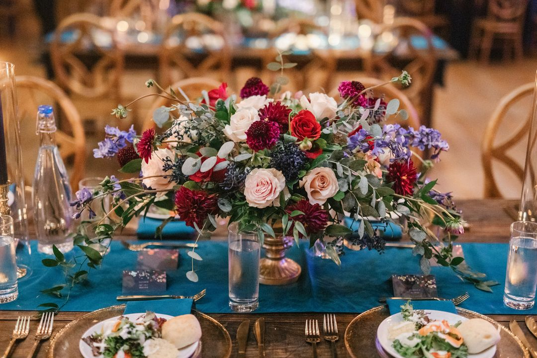 bold burgundy and blue wedding tablescape