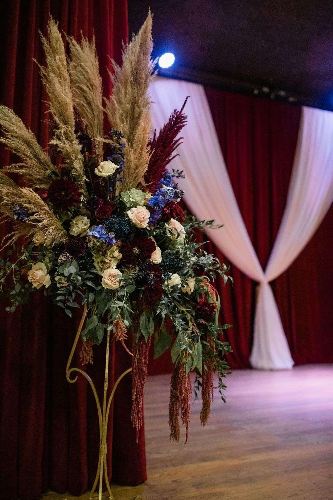 wedding ceremony burgundy and blue boho florals
