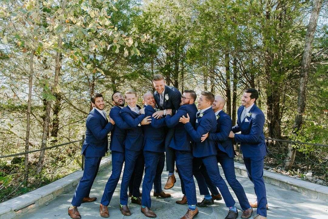 groomsmen having fun in navy suits
