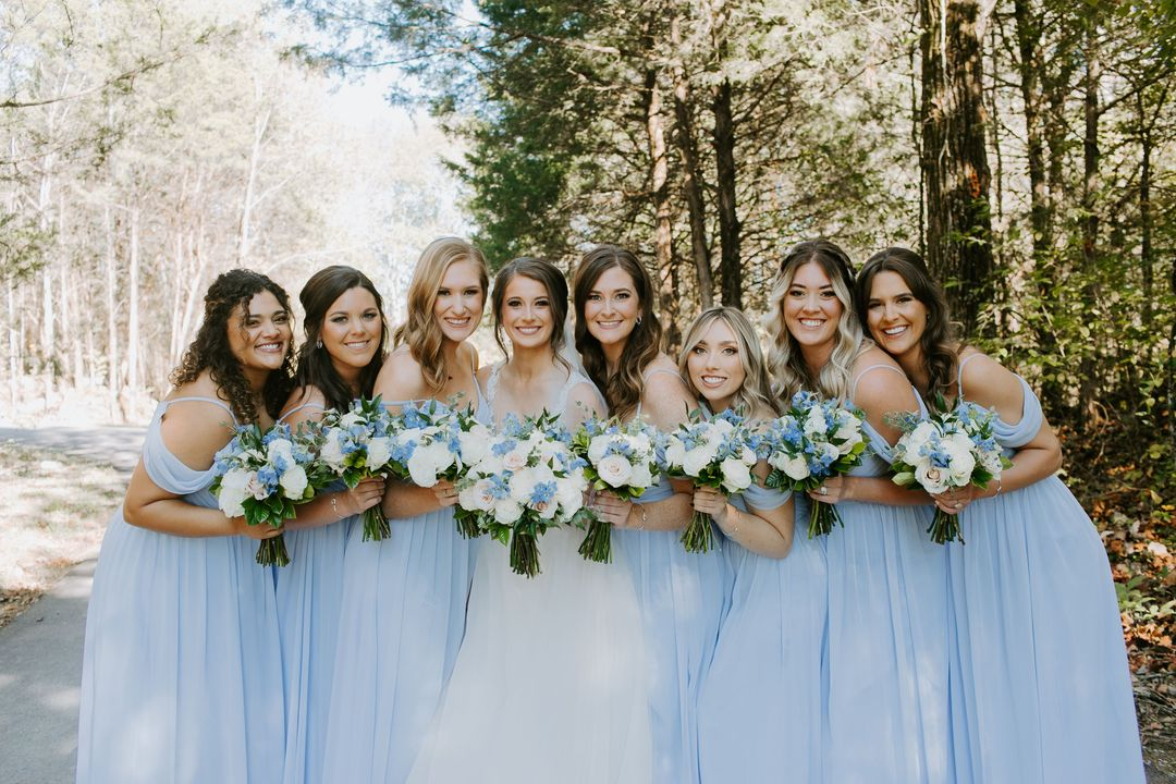 white and blue wedding, bridal party in pastel blue dresses with white and blue bouquets