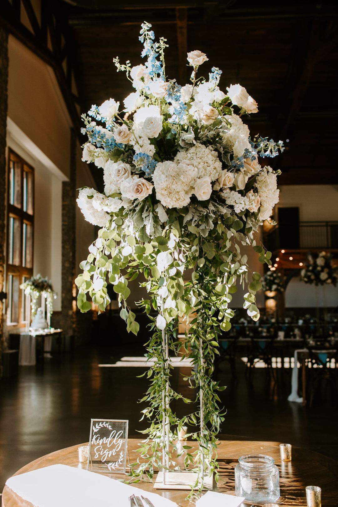 white and blue wedding, tall floral centerpiece with flowers by Enchanted Florist