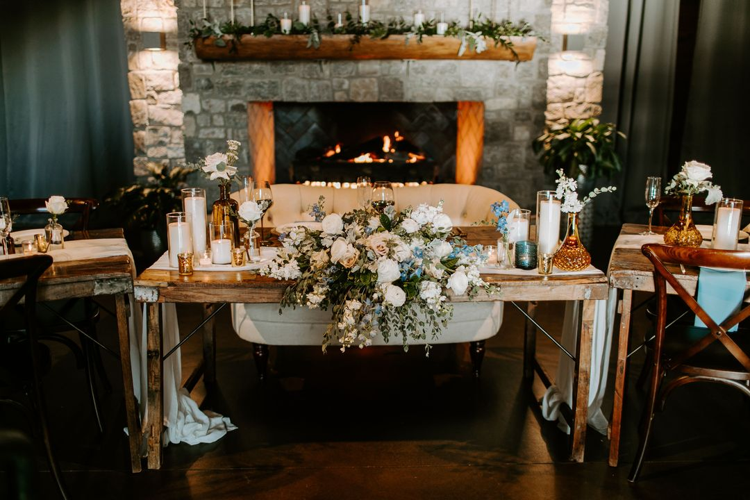 white and blue wedding, sweetheart table with flowers by Enchanted Florist