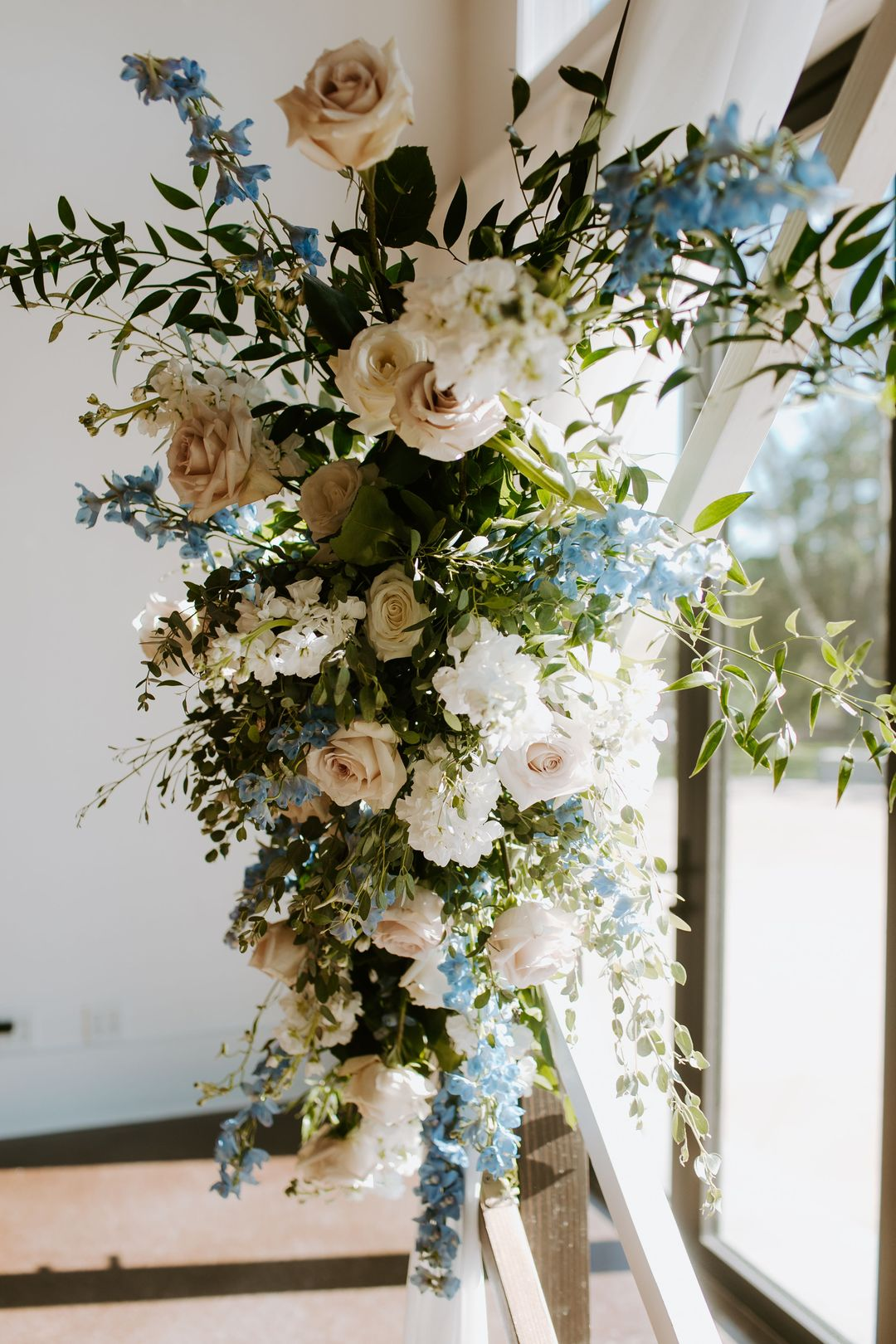 white and blue wedding, wedding ceremony flowers by Enchanted Florist