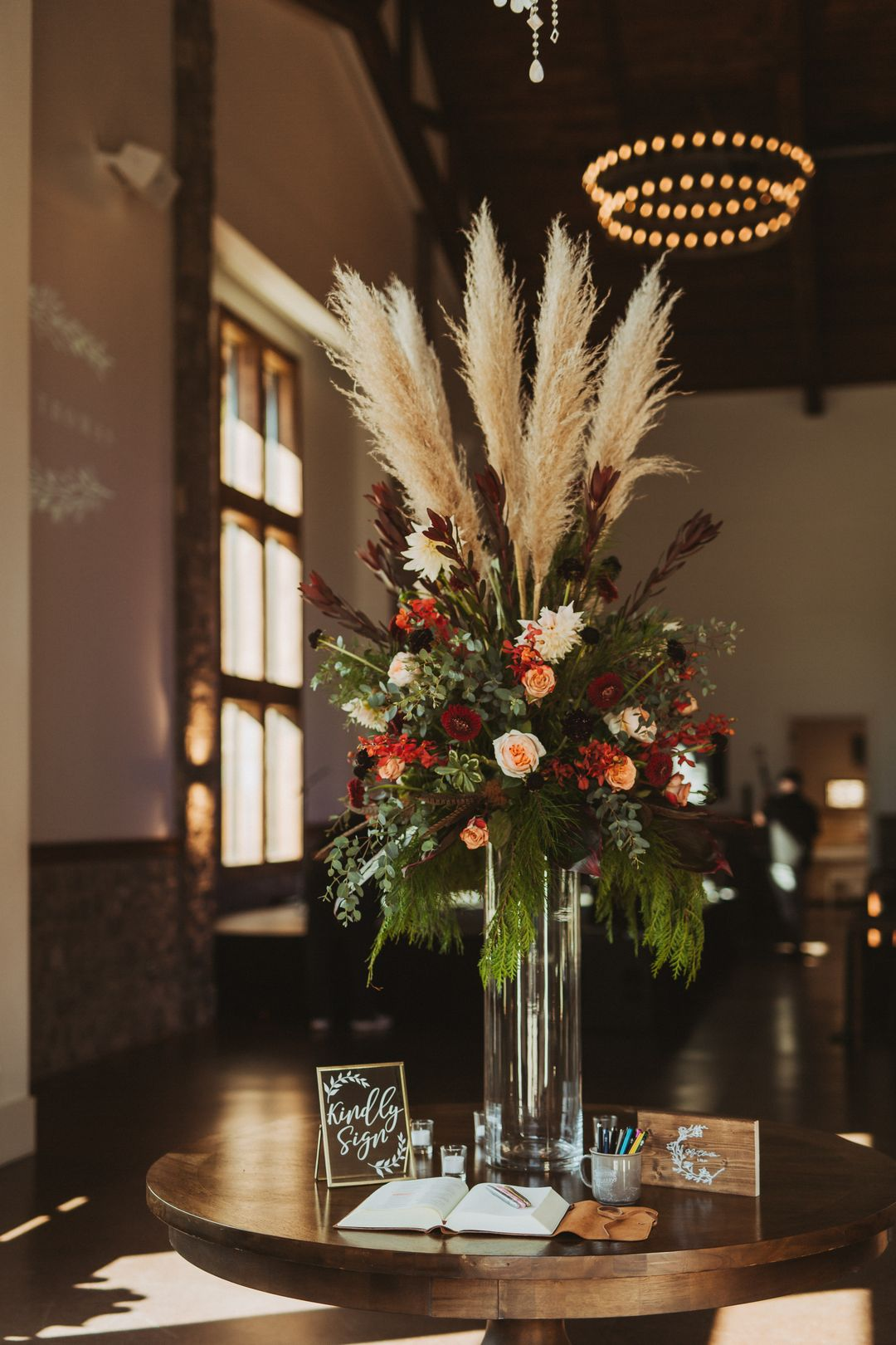 tall emerald and red wedding flower centerpiece with pampas grass