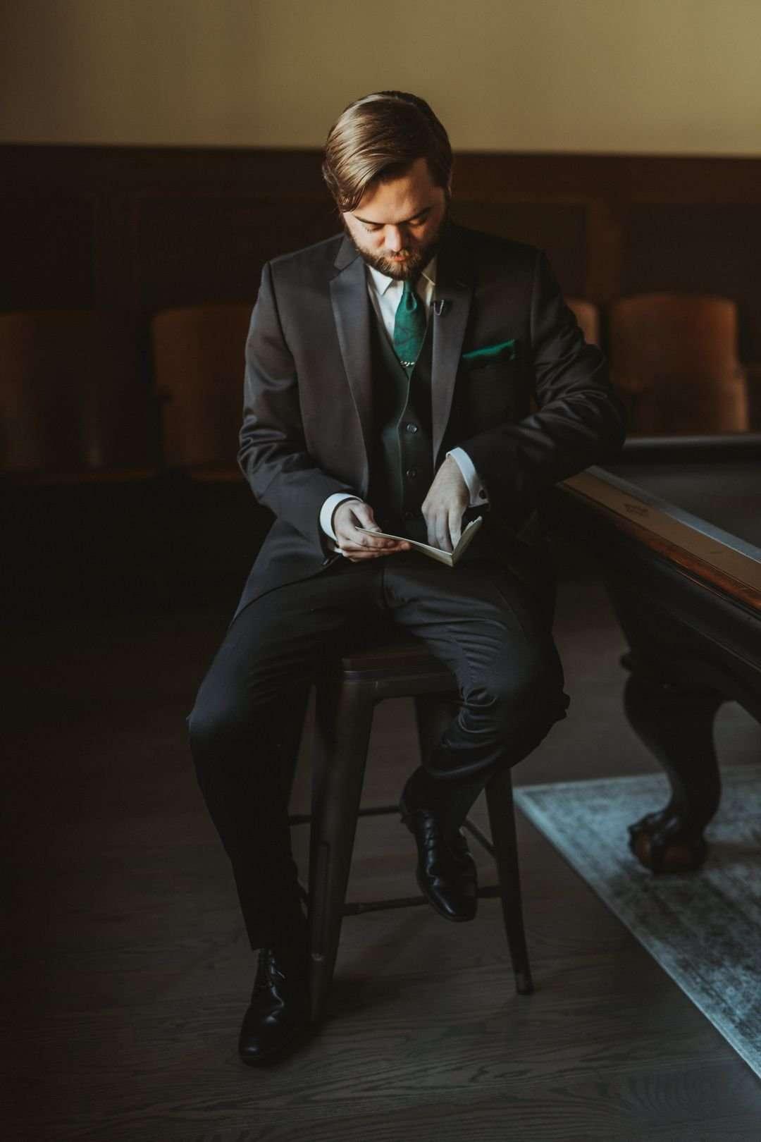 emerald and black groom attire