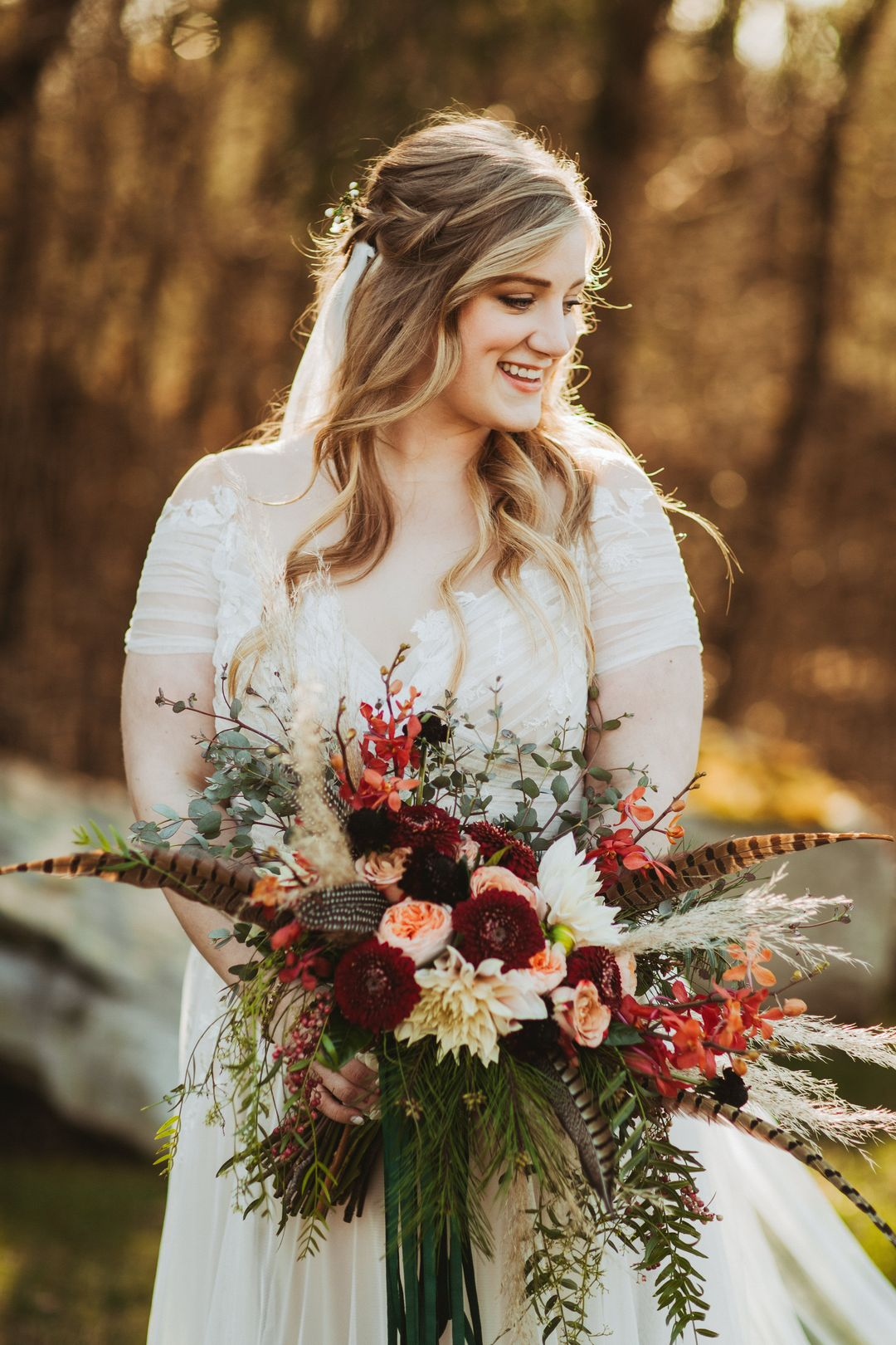 boho bride with emerald and red wedding flower bouquet