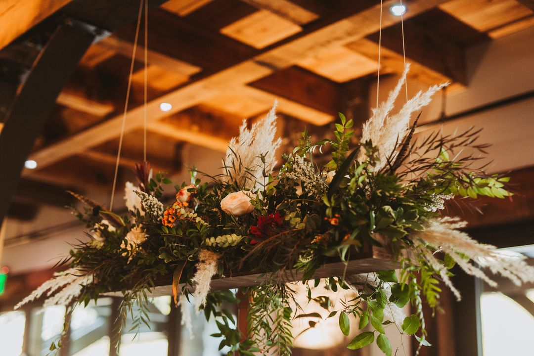 emerald and red wedding flowers over reception table