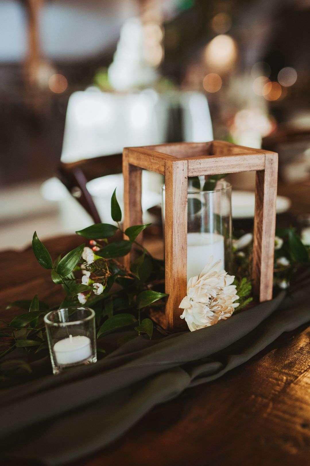 wood tabletop lantern wedding centerpiece