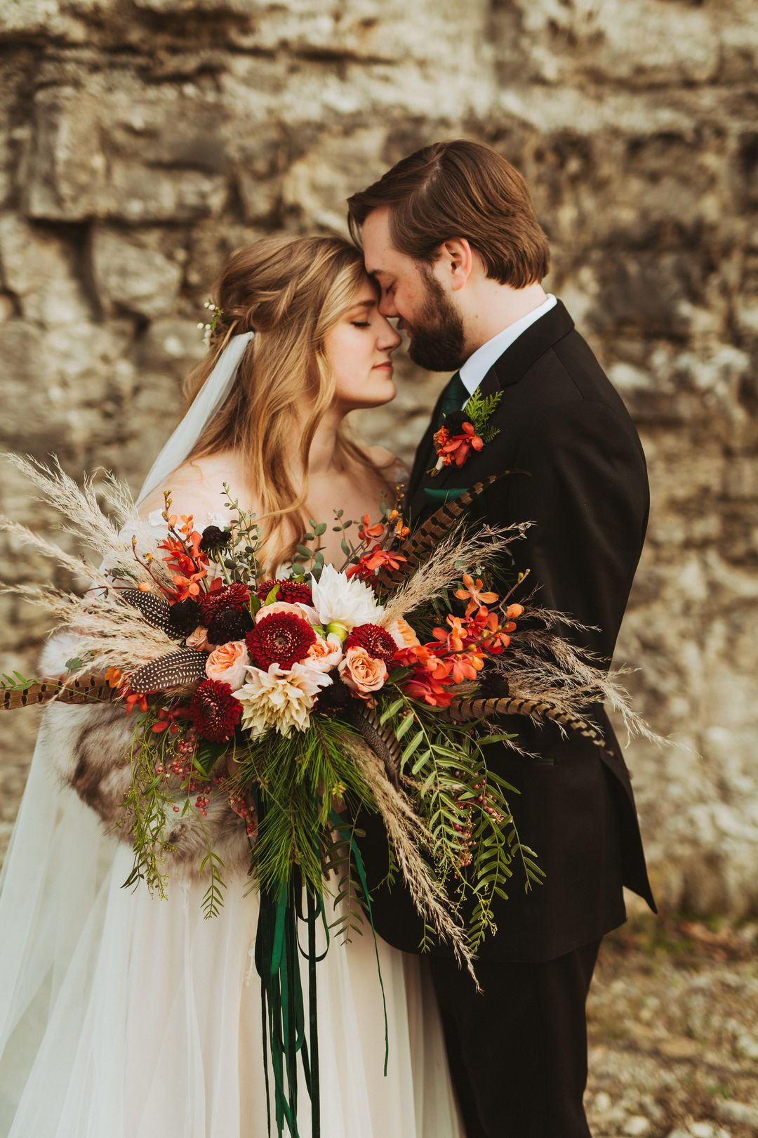 emerald and red boho wedding bride and groom portraits
