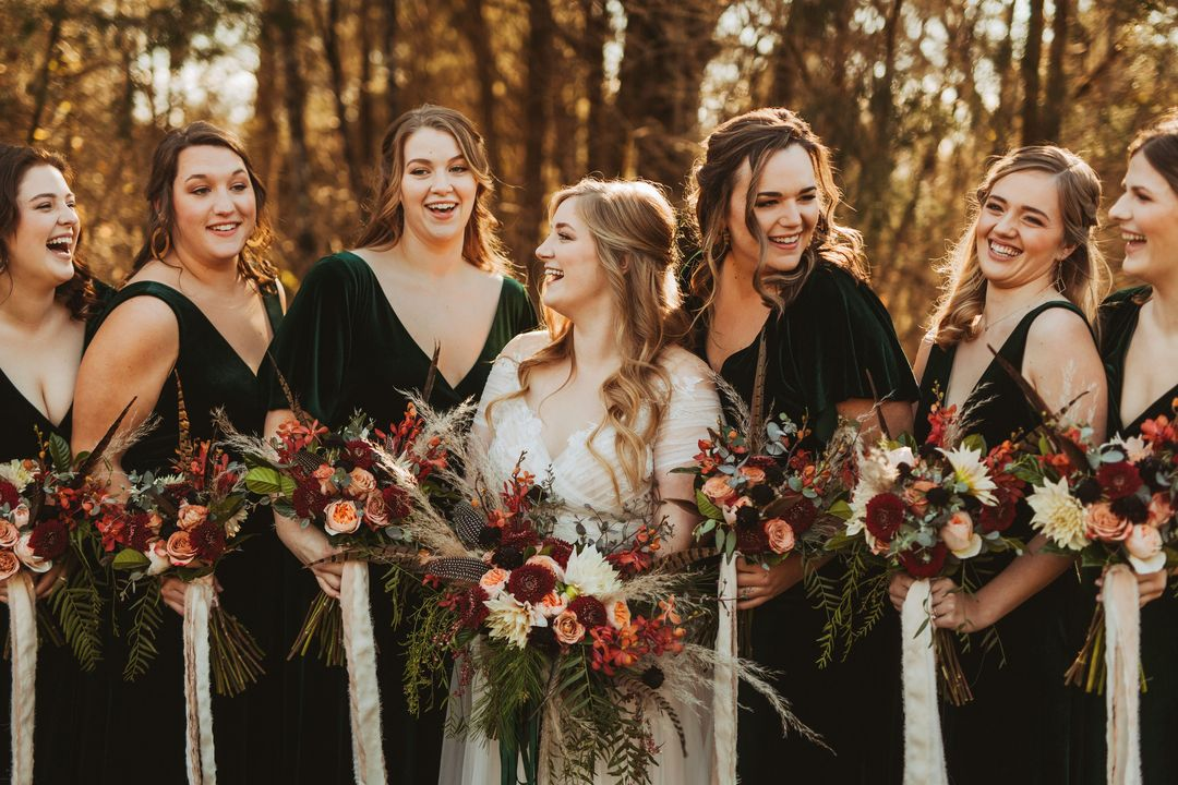 emerald bridesmaid dresses with boho bridal bouquets