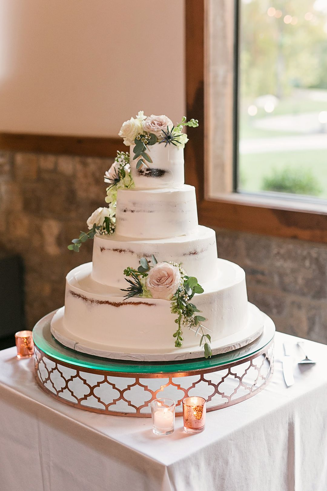 wedding cake with white and pink flowers