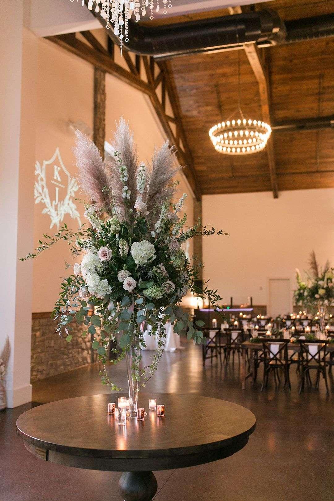 tall floral arrangement with pampas grass