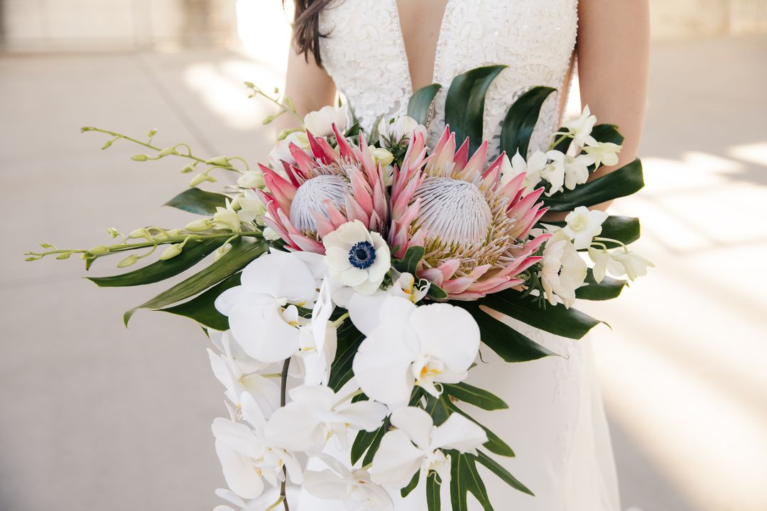 tropical bridal bouquet, white orchids and pink king proteas