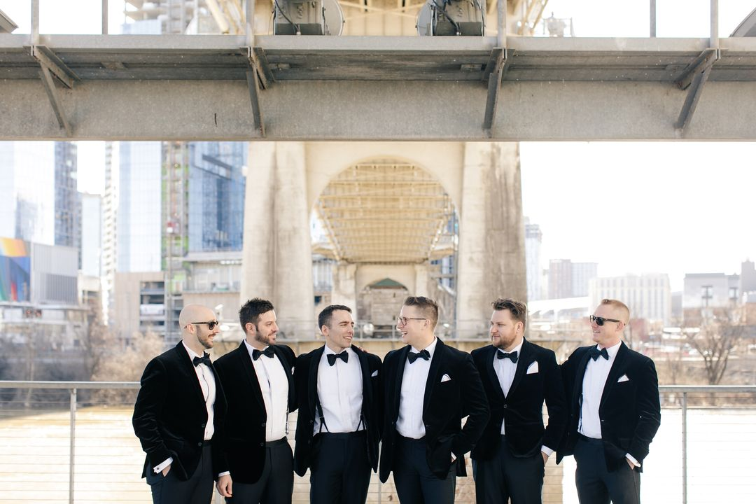 groom and groomsmen in tuxedos