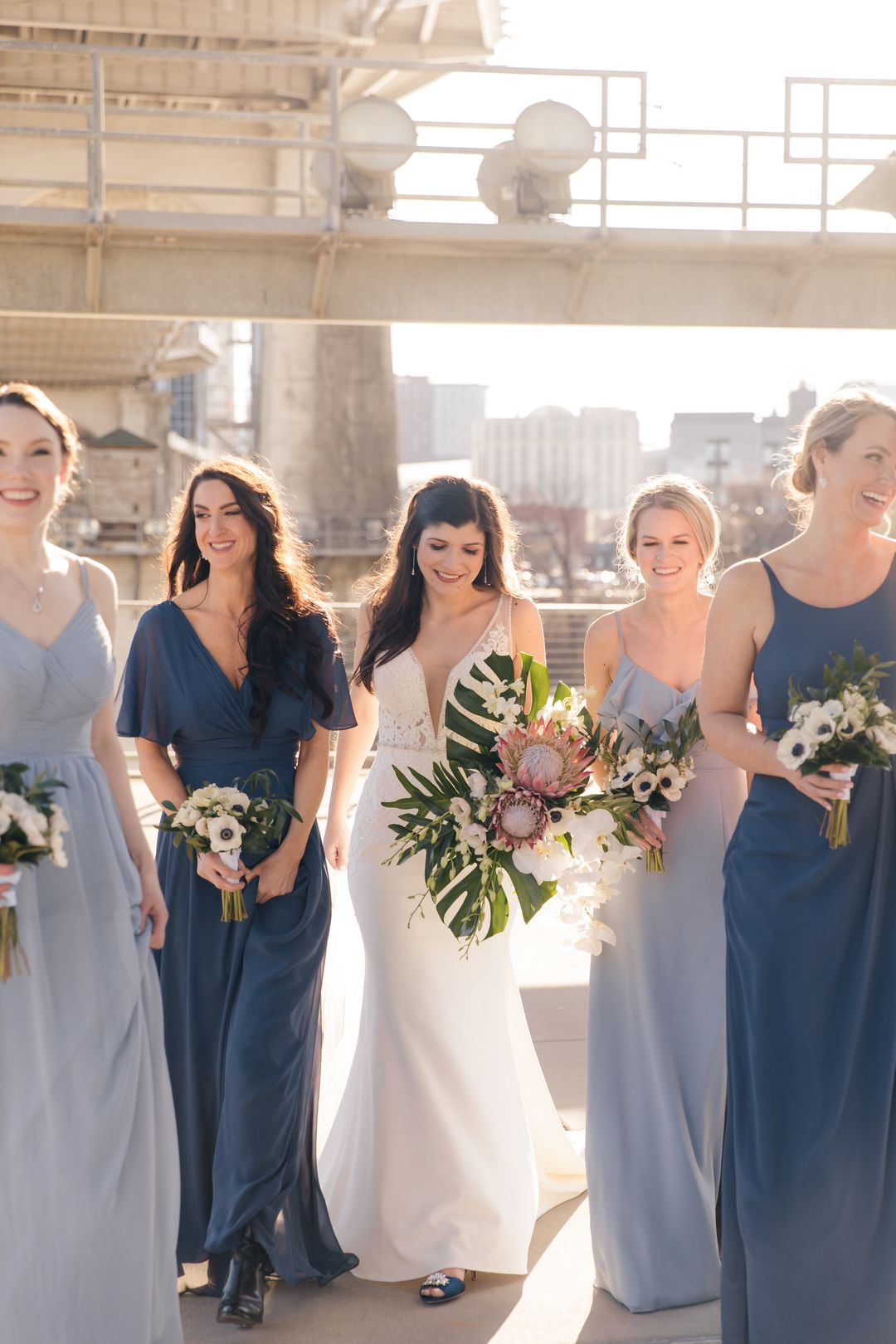 tropical bridesmaid bouquets, mismatched blue bridesmaid dresses