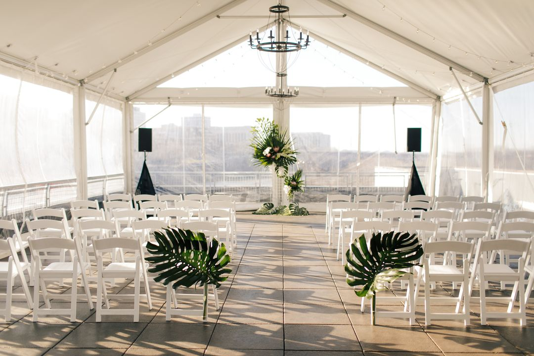 topical themed wedding ceremony under tent