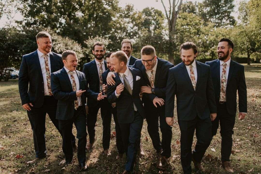 groomsmen with orange floral ties