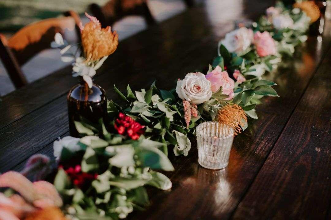 wedding reception centerpiece garland with flowers