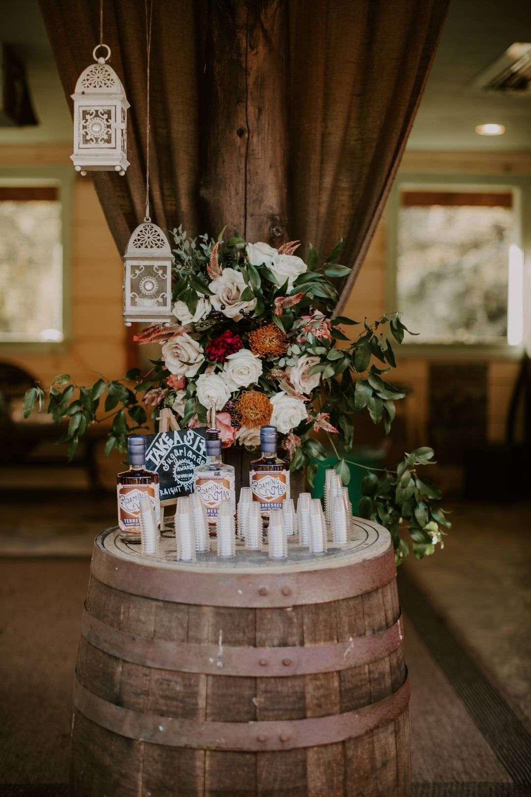 orange red and white wedding floral arrangement