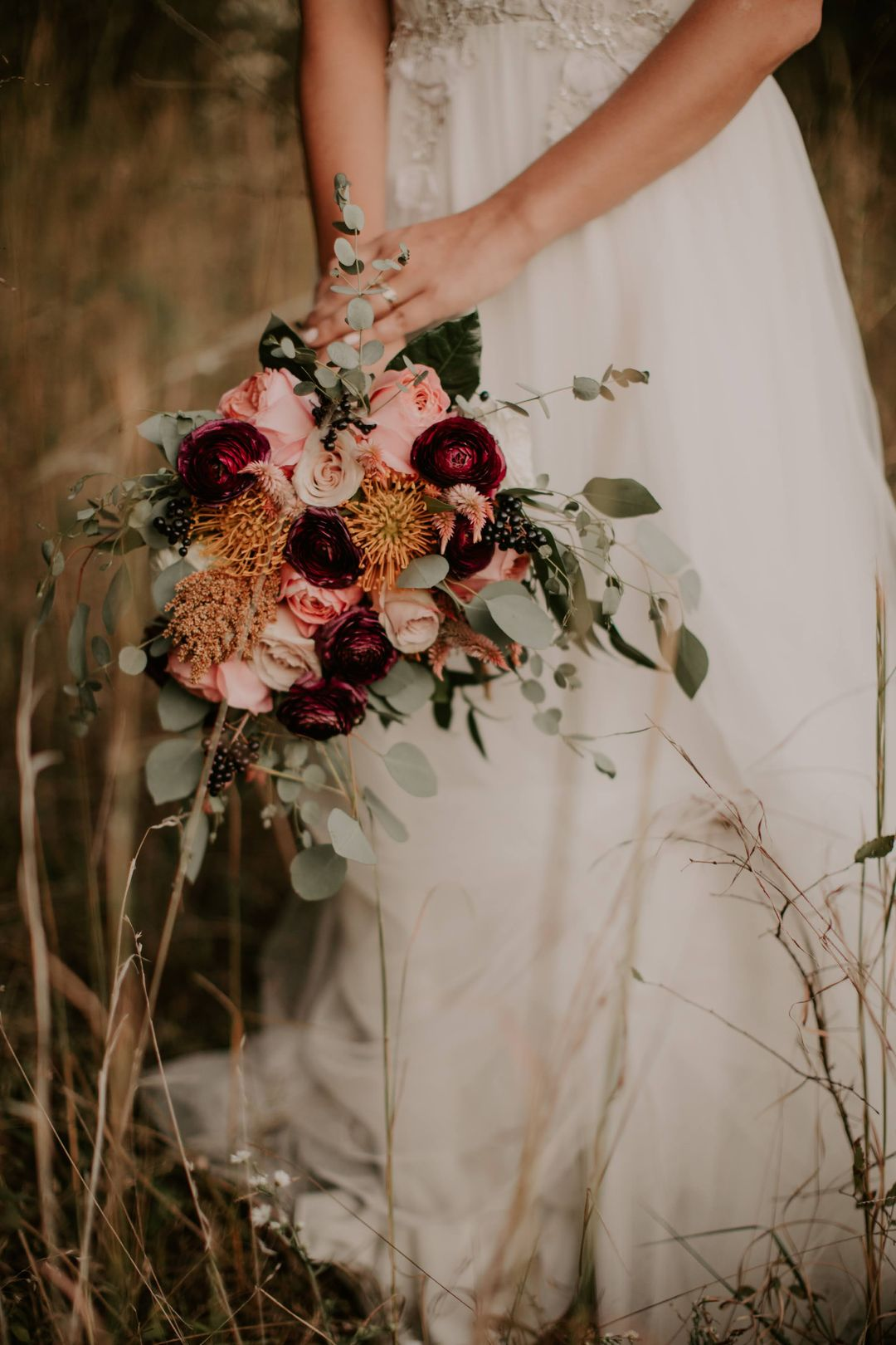 orange red and pink boho bridal bouquet