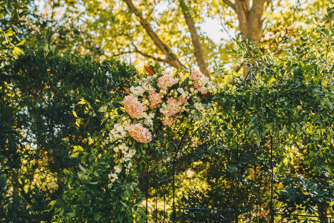 pink and white outdoor ceremony florals