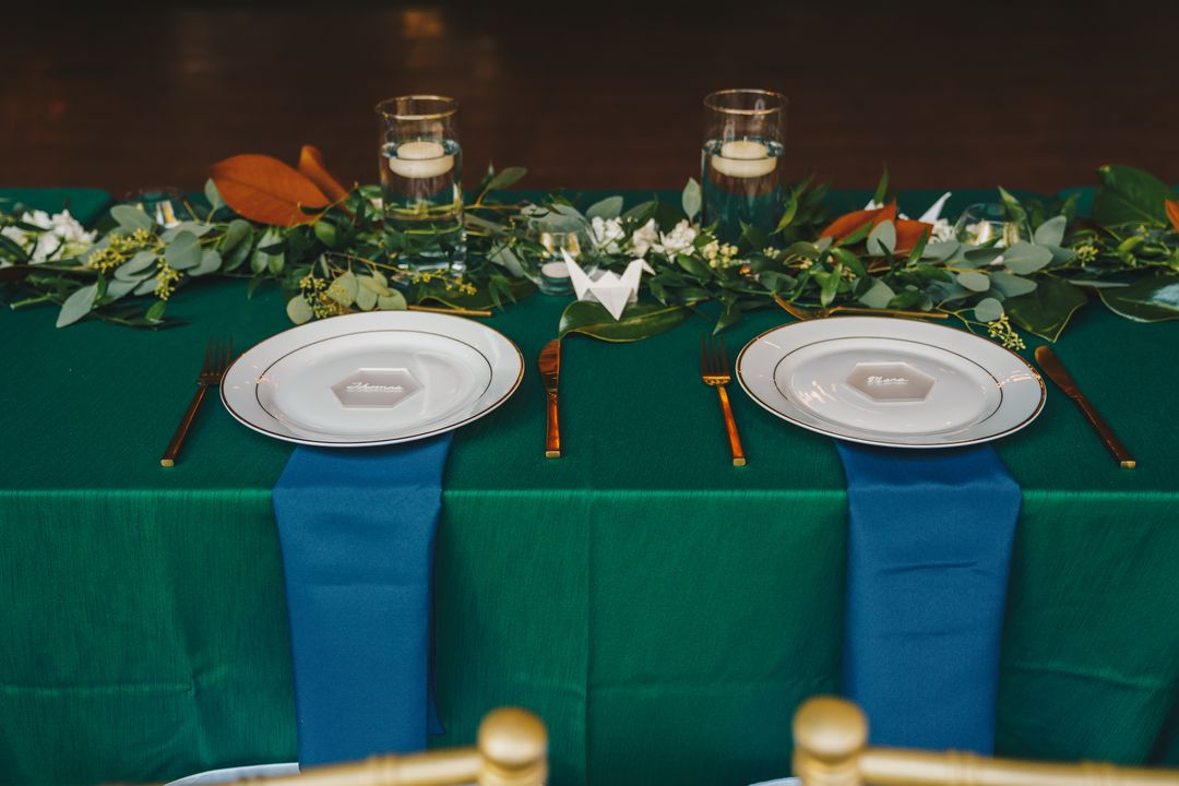 green and blue wedding sweetheart table place settings
