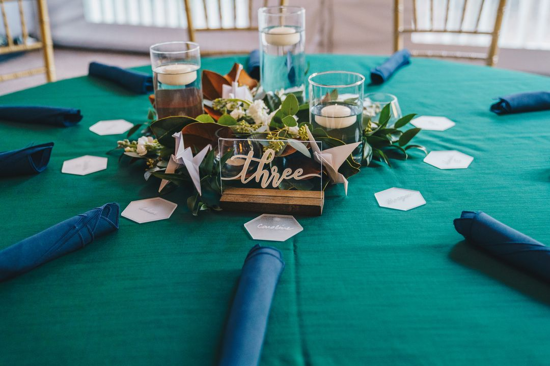 blue and green wedding reception table, greenery centerpiece