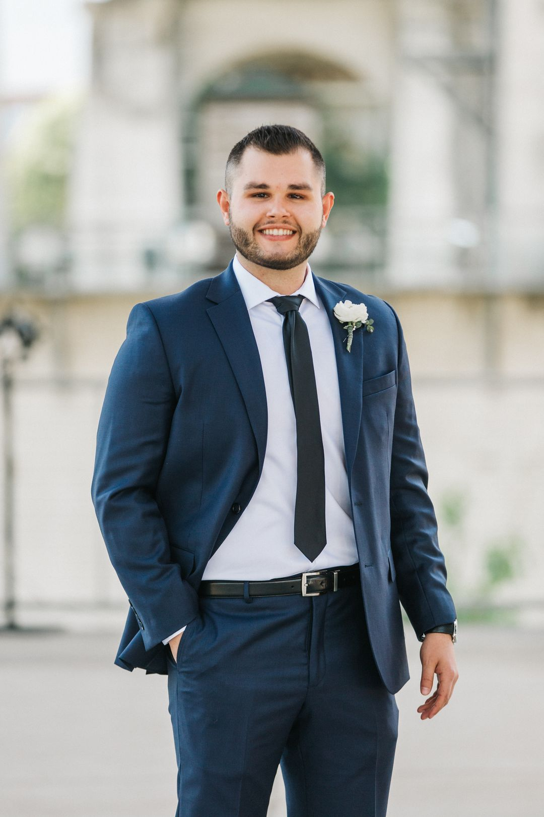navy groom with white boutonierre