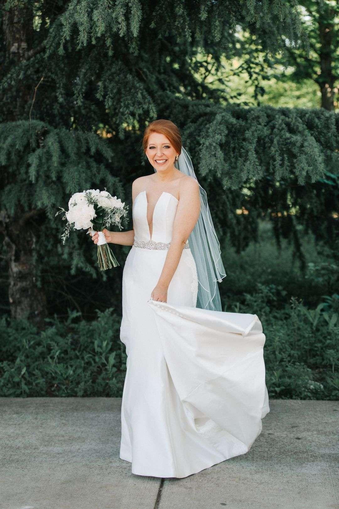 brie wearing white wedding dress, bridal portraits