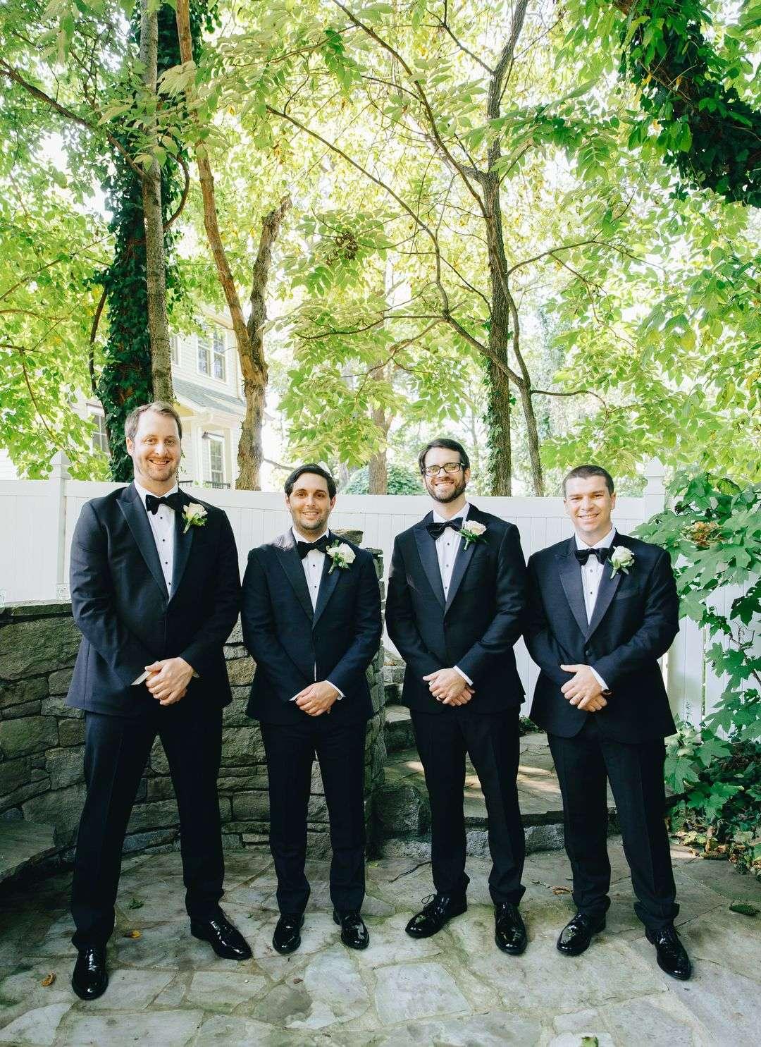 black navy groomsmen suits