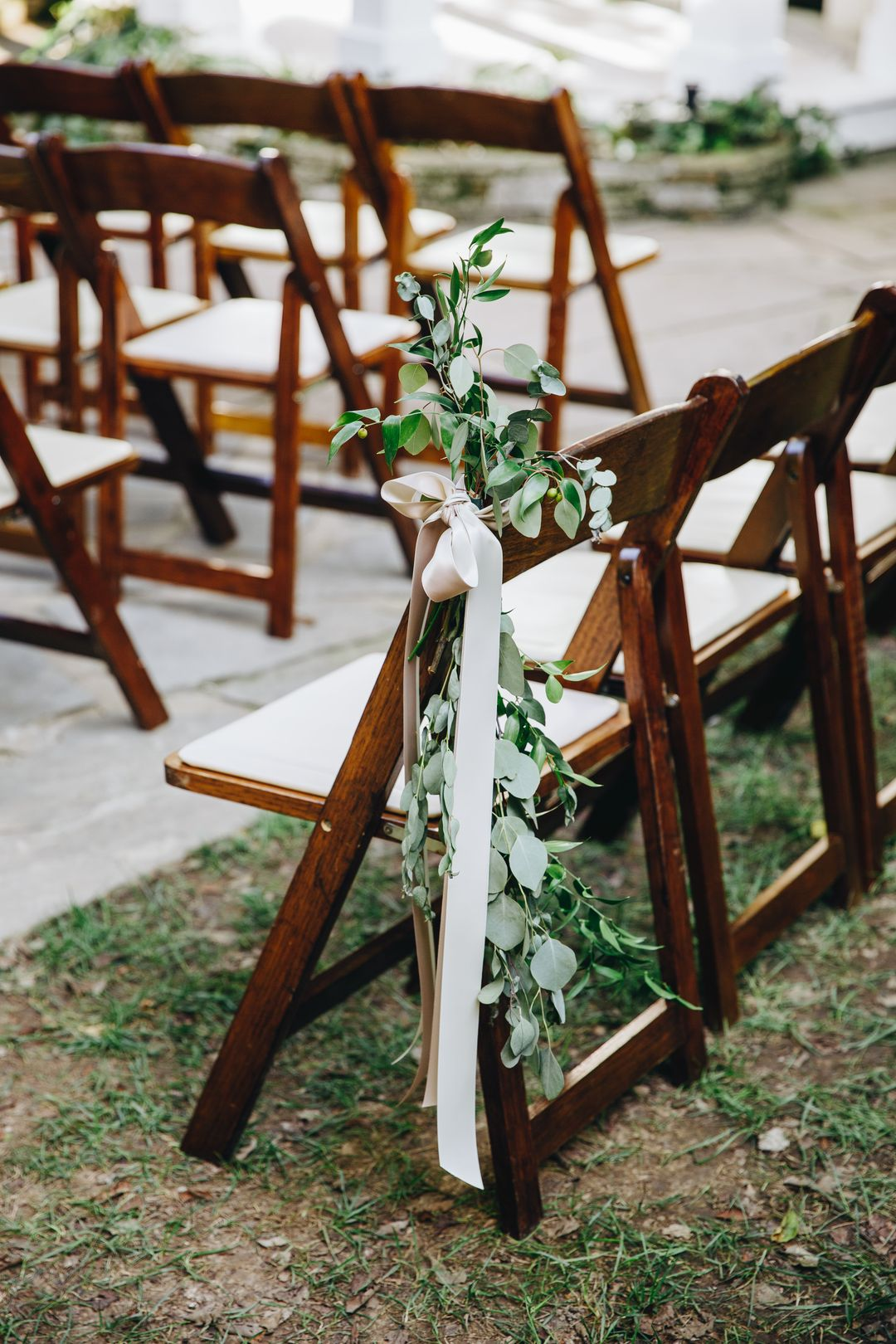 outdoor ceremony aisle seat floral decor