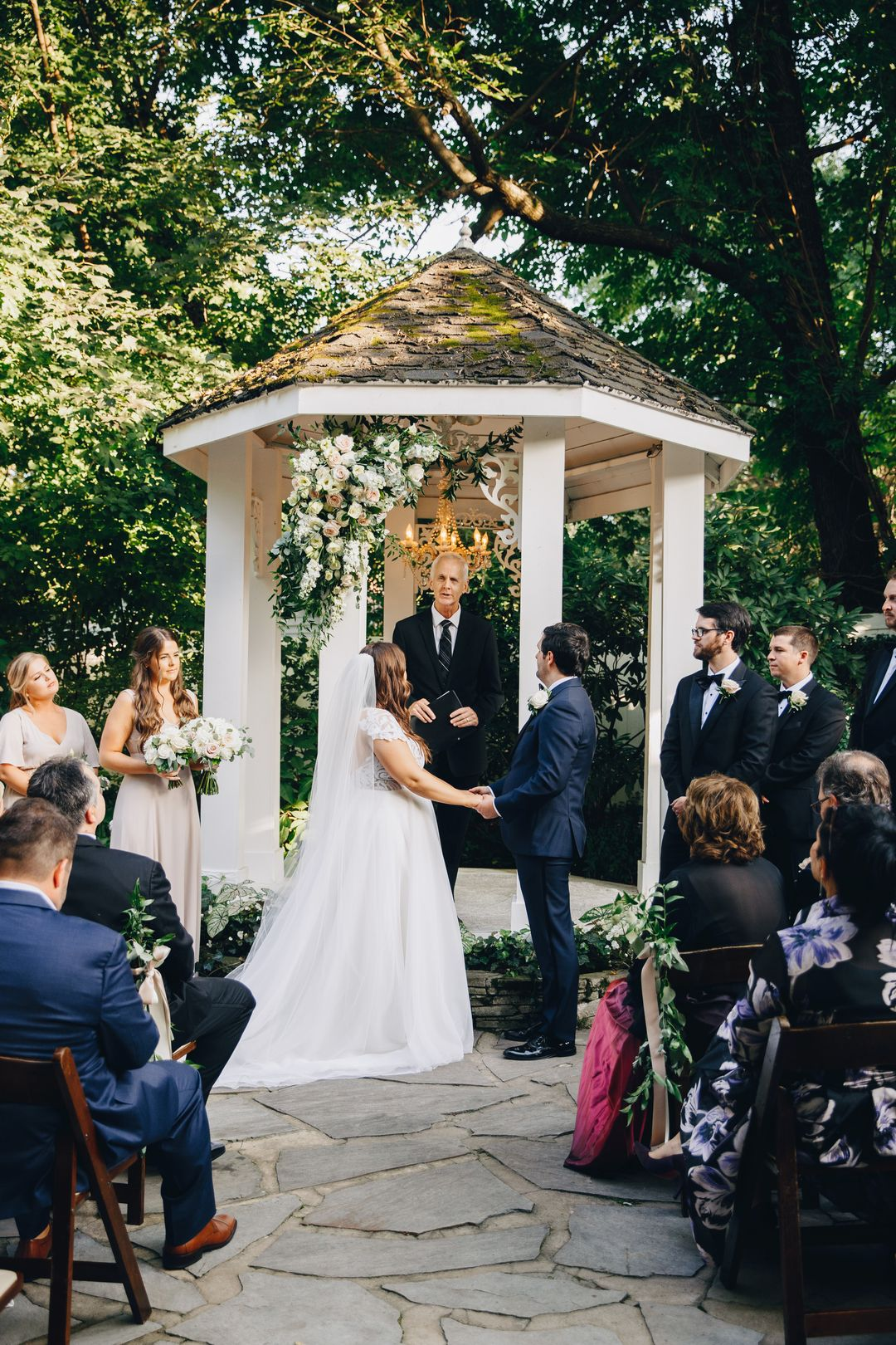 blush and white outdoor wedding ceremony backdrop flowers