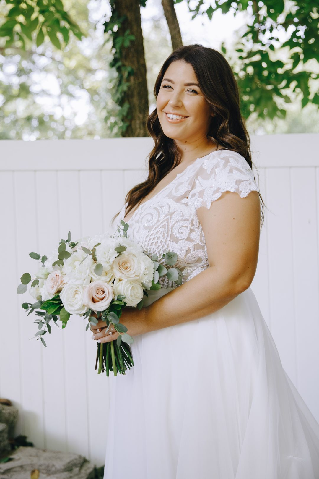 romantic bride with blush and white bouquet