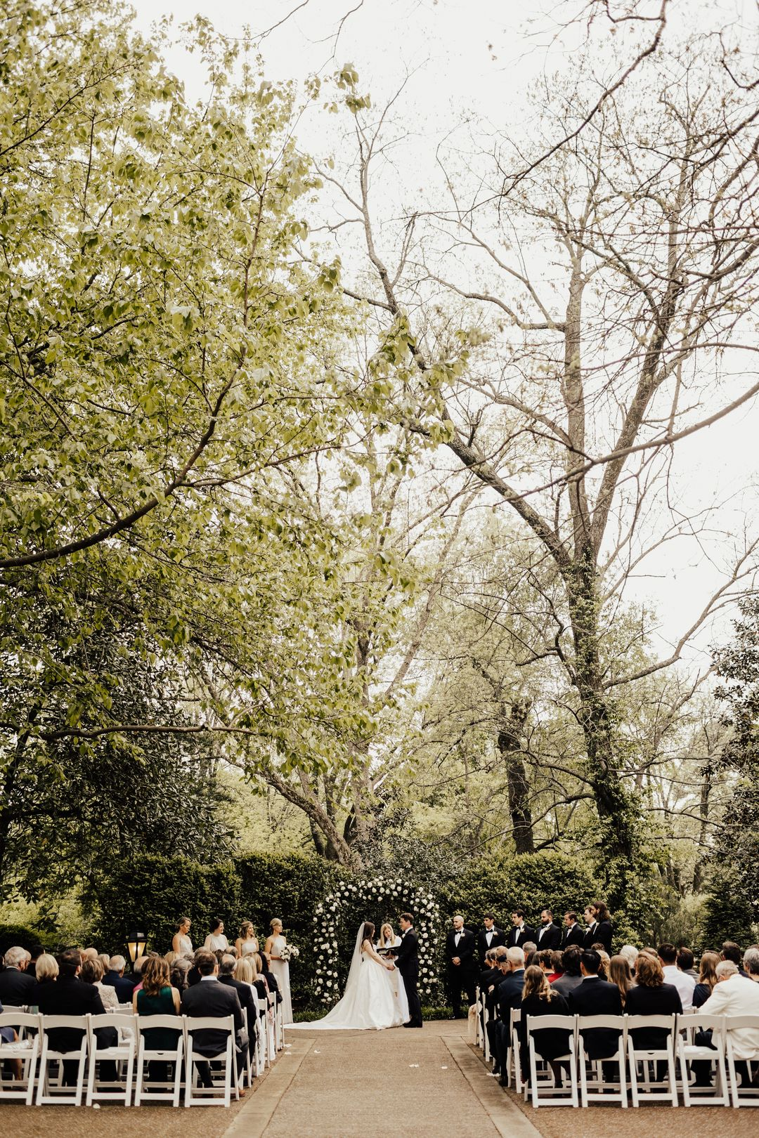 outdoor wedding ceremony at riverwood mansion