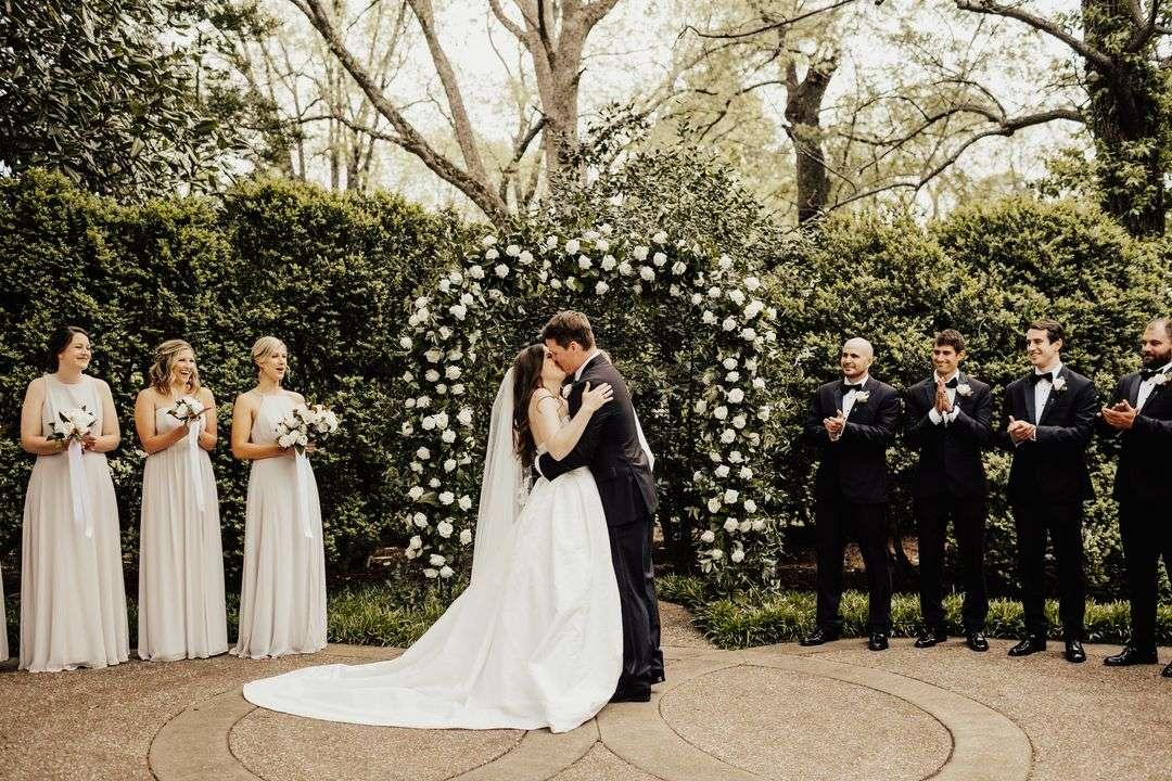 white and green wedding ceremony arbor