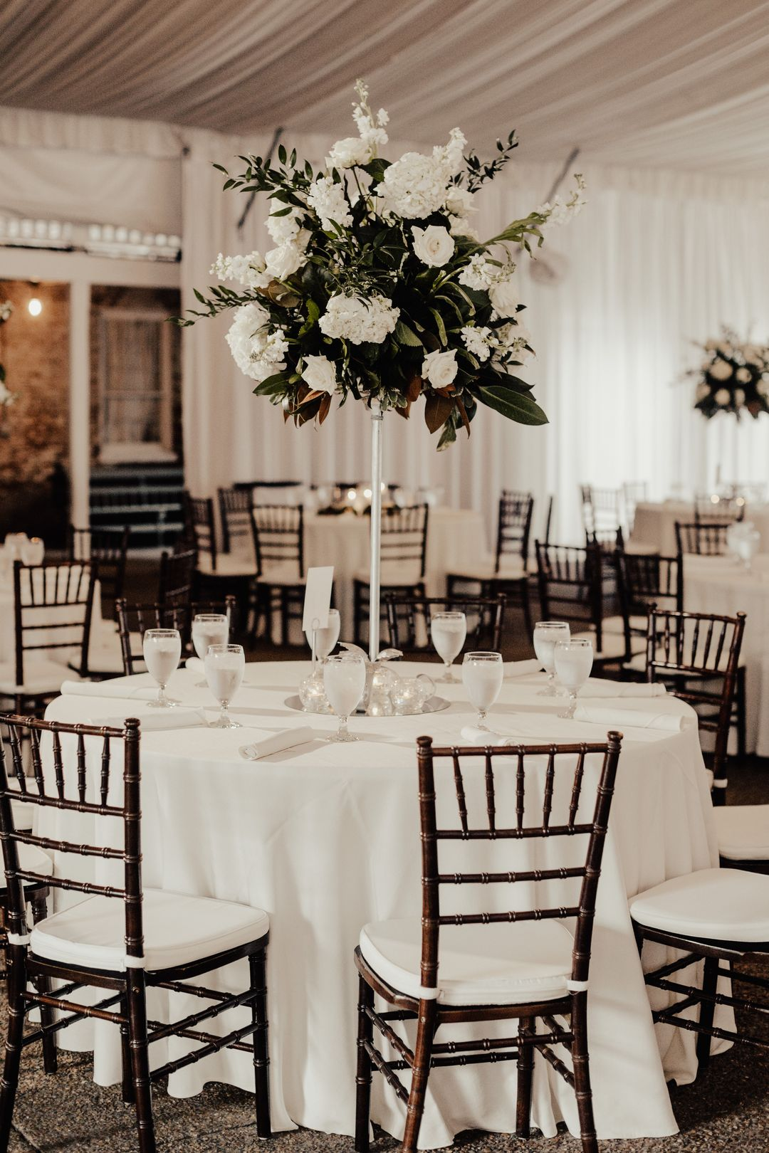 tall white and green wedding reception centerpieces