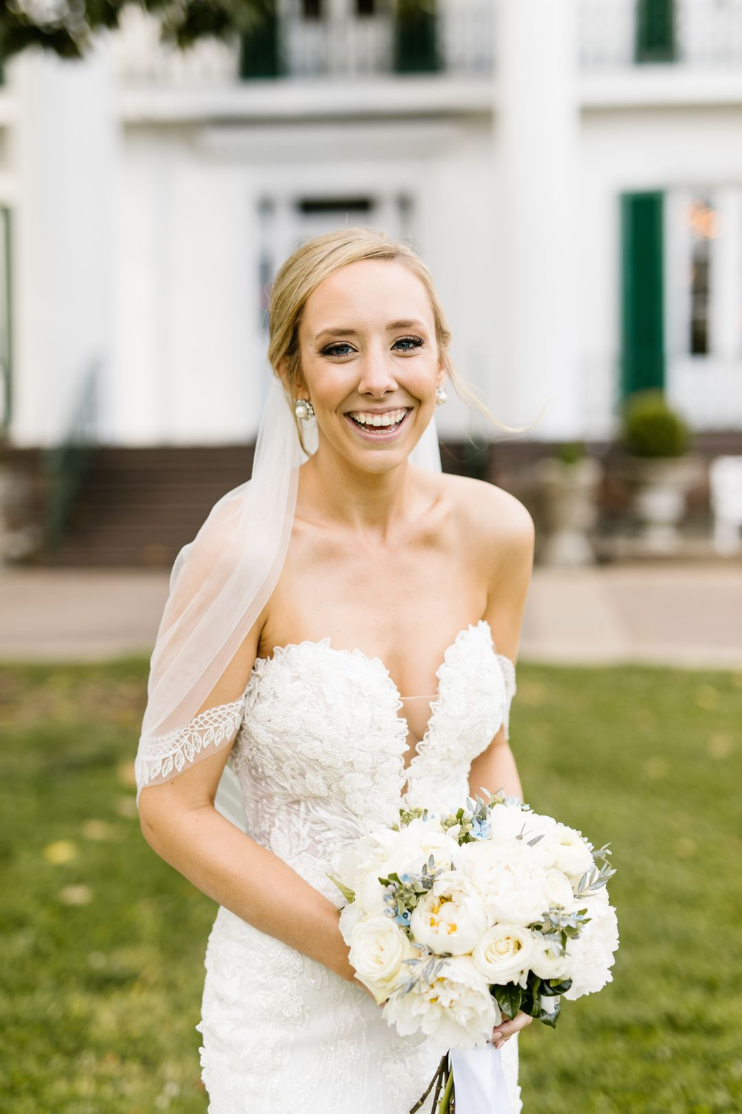 white wedding dress with all white bridal bouquet