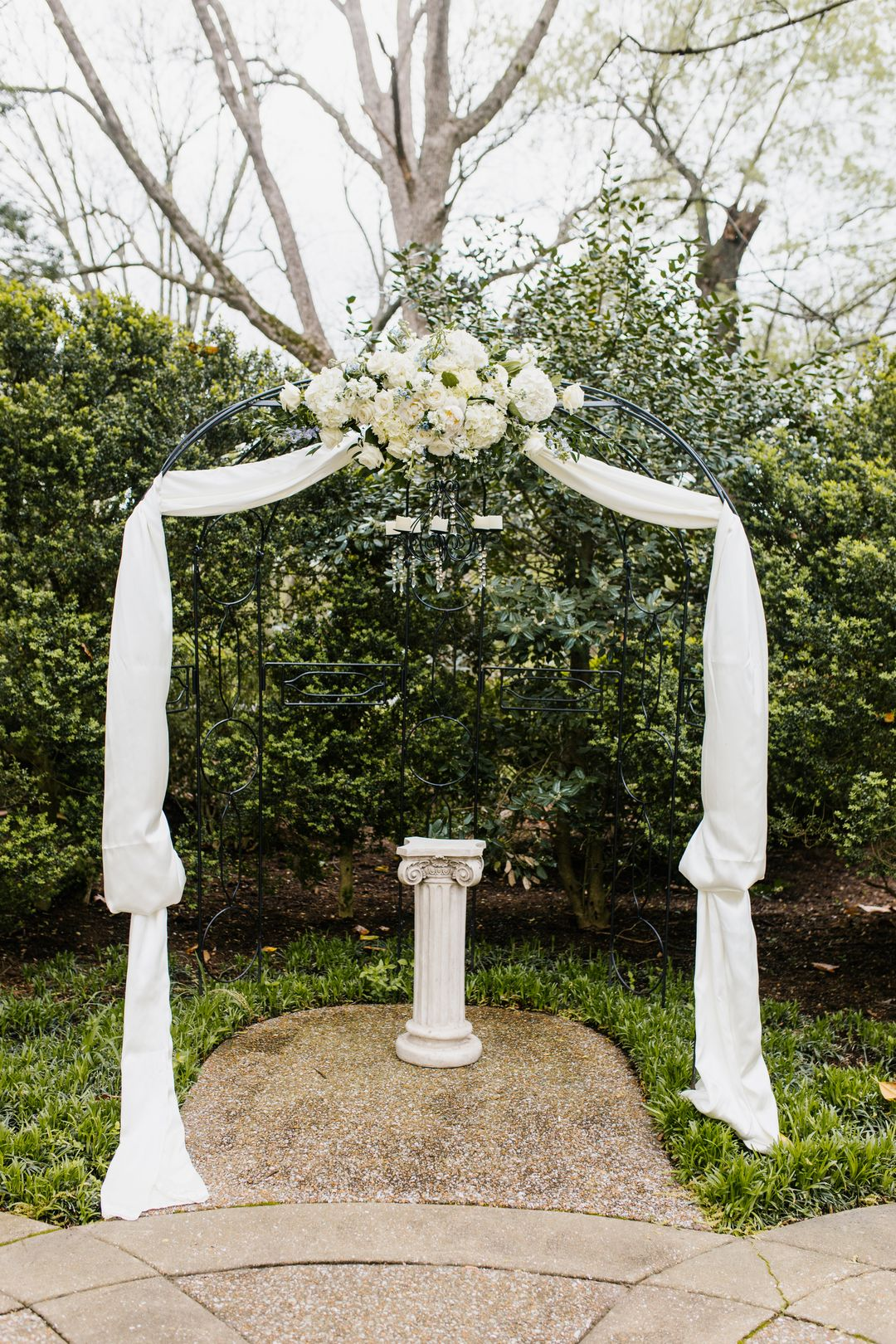 metal arbor with drapery for wedding backdrop