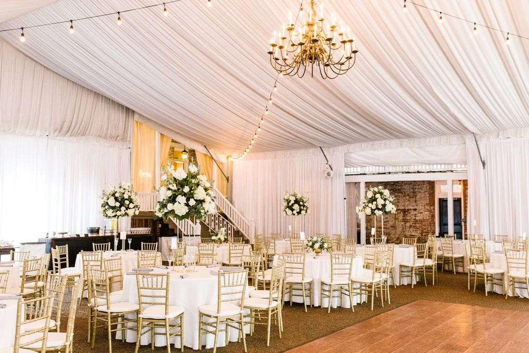 indoor tented wedding reception at riverwood mansion